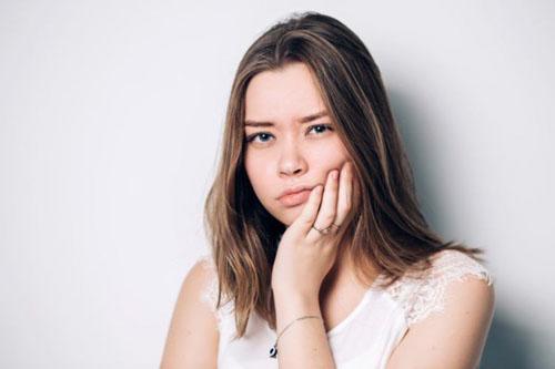 Nhức răng sau khi trám nên làm gì?